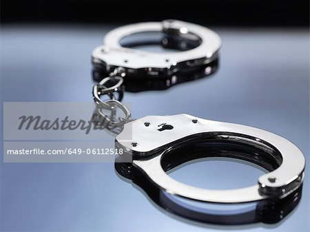Close up of metal handcuffs Stock Photo - Premium Royalty-Free, Image code: 649-06112518