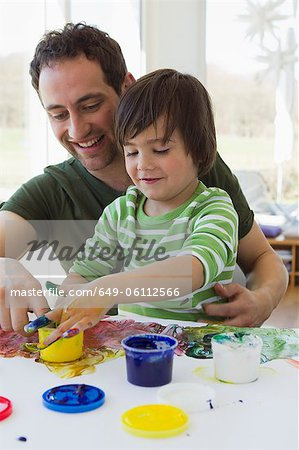 Father and son finger painting together Stock Photo - Premium Royalty-Free, Image code: 649-06112566