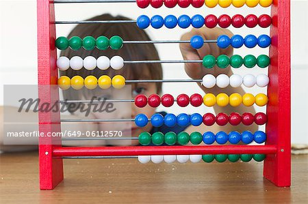Boy playing with abacus Stock Photo - Premium Royalty-Free, Image code: 649-06112570