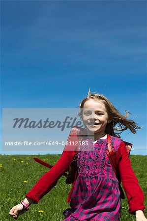 Smiling girl wearing backpack outdoors