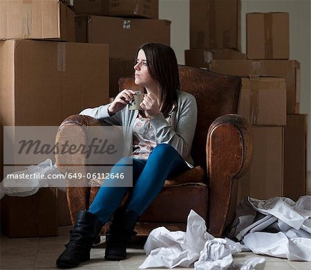 Teenage girl having coffee in new home Stock Photo - Premium Royalty-Free, Image code: 649-06112646