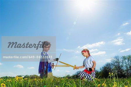 Boys playing dress up outdoors Stock Photo - Premium Royalty-Free, Image code: 649-06112823