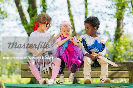 Children playing dress up outdoors Stock Photo - Premium Royalty-Free, Image code: 649-06112824