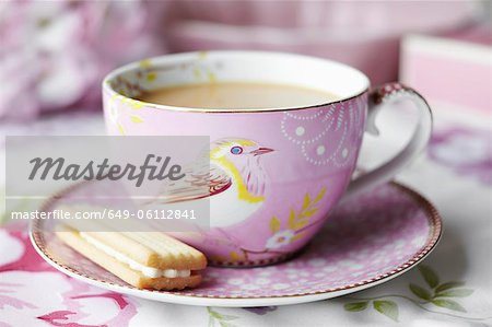 Close up of cup of tea and cookie Stock Photo - Premium Royalty-Free, Image code: 649-06112841