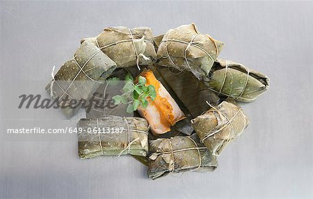 Tamales, wrapped in banana leaves Stock Photo - Premium Royalty-Free, Image code: 649-06113187