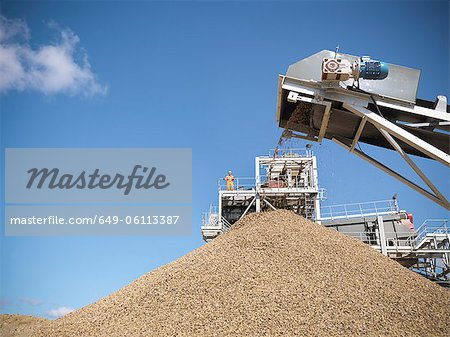 Stones pouring in pile from conveyor Stock Photo - Premium Royalty-Free, Image code: 649-06113387