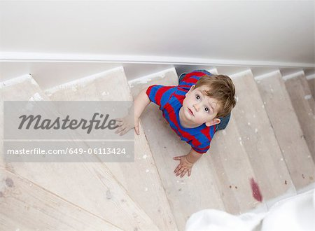 Toddler boy climbing steps Stock Photo - Premium Royalty-Free, Image code: 649-06113424
