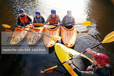 Teacher talking to students in kayaks Stock Photo - Premium Royalty-Free, Image code: 649-06113544
