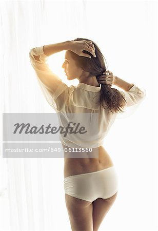 Woman posing in shirt and panties Stock Photo - Premium Royalty-Free, Image code: 649-06113560
