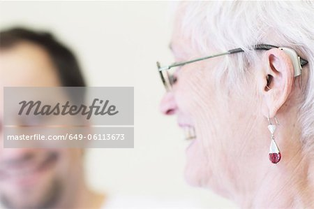 Close up of womans hearing aid Stock Photo - Premium Royalty-Free, Image code: 649-06113673