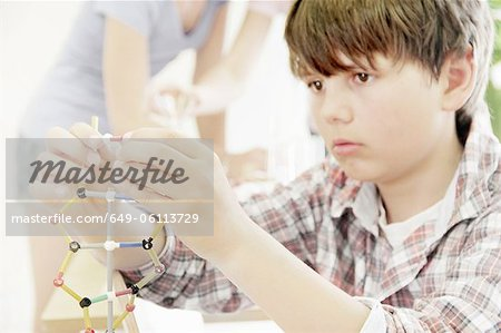 Boy making molecular model in class Stock Photo - Premium Royalty-Free, Image code: 649-06113729