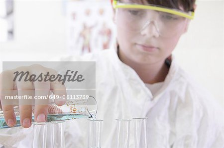 Student pouring liquid into test tube Stock Photo - Premium Royalty-Free, Image code: 649-06113739