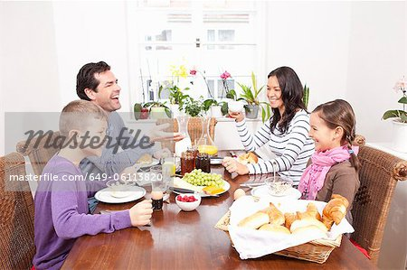 Family eating breakfast at table Stock Photo - Premium Royalty-Free, Image code: 649-06113820