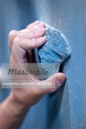 Close up of a climbers hand on an artificial handhold at a climbers gym Stock Photo - Premium Royalty-Free, Image code: 649-06113913