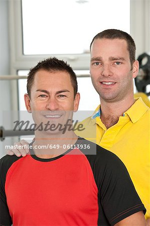 Trainer and client laughing in gym Stock Photo - Premium Royalty-Free, Image code: 649-06113936