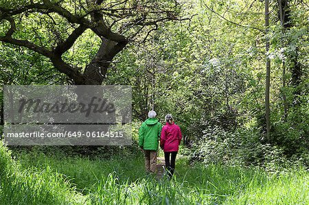 Older couple walking in forest Stock Photo - Premium Royalty-Free, Image code: 649-06164515