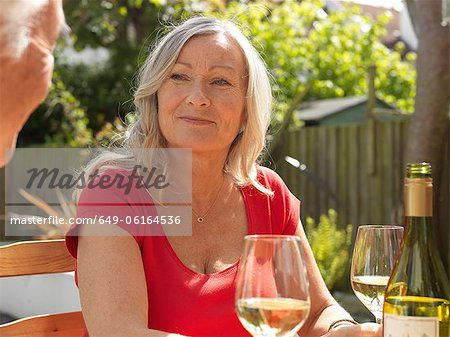Older couple drinking wine together Stock Photo - Premium Royalty-Free, Image code: 649-06164536
