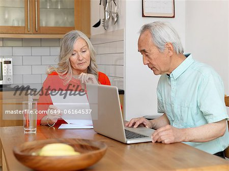 Older couple paying bills online Stock Photo - Premium Royalty-Free, Image code: 649-06164537