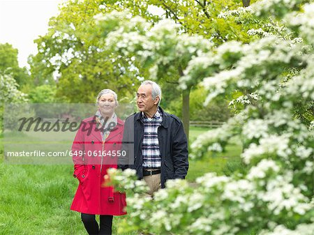 Older couple walking together in park Stock Photo - Premium Royalty-Free, Image code: 649-06164550
