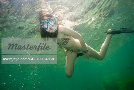 Girl snorkeling in tropical waters Stock Photo - Premium Royalty-Free, Image code: 649-06164858