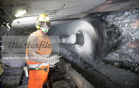 Coal miner working in mine Stock Photo - Premium Royalty-Free, Image code: 649-06164913