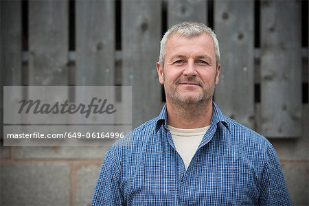 Smiling man standing outside Stock Photo - Premium Royalty-Free, Image code: 649-06164996