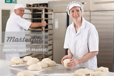 Chef baking in kitchen Stock Photo - Premium Royalty-Free, Image code: 649-06165014