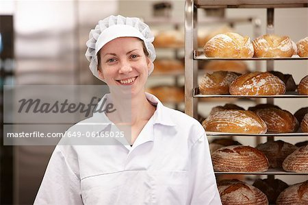 Smiling chef standing in kitchen Stock Photo - Premium Royalty-Free, Image code: 649-06165025
