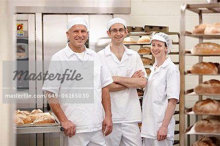 Chefs smiling together in kitchen Stock Photo - Premium Royalty-Free, Image code: 649-06165030