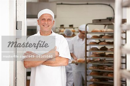 Chef smiling in kitchen Stock Photo - Premium Royalty-Free, Image code: 649-06165040