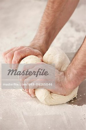 Chef kneading dough in kitchen Stock Photo - Premium Royalty-Free, Image code: 649-06165046