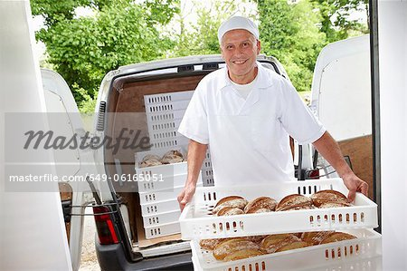 Chef carrying trays of bread to van Stock Photo - Premium Royalty-Free, Image code: 649-06165051