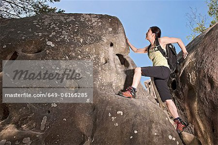 Climber scaling steep boulders Stock Photo - Premium Royalty-Free, Image code: 649-06165285