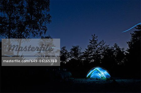 Glowing lights in tent at campsite Stock Photo - Premium Royalty-Free, Image code: 649-06165308