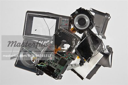 Pile of smashed camera parts Stock Photo - Premium Royalty-Free, Image code: 649-06165313