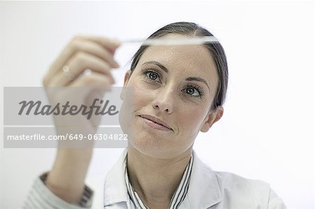 Doctor reading test strip Stock Photo - Premium Royalty-Free, Image code: 649-06304822