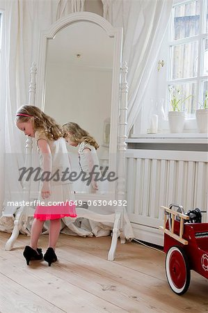 Girl wearing mothers high heels Stock Photo - Premium Royalty-Free, Image code: 649-06304932