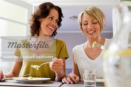 Smiling women having lunch together Stock Photo - Premium Royalty-Free, Image code: 649-06304999