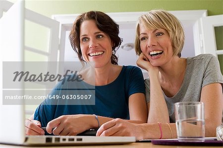 Women using laptop together Stock Photo - Premium Royalty-Free, Image code: 649-06305007
