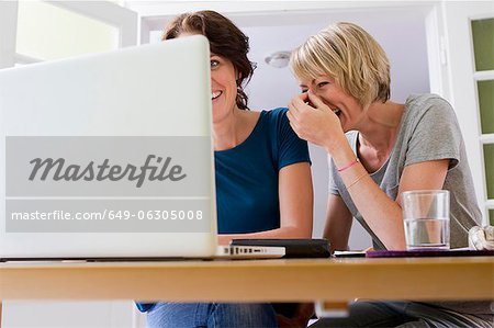 Women using laptop together Stock Photo - Premium Royalty-Free, Image code: 649-06305008