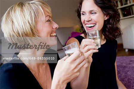 Women drinking champagne together Stock Photo - Premium Royalty-Free, Image code: 649-06305010