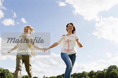Smiling women running outdoors Stock Photo - Premium Royalty-Free, Image code: 649-06305015