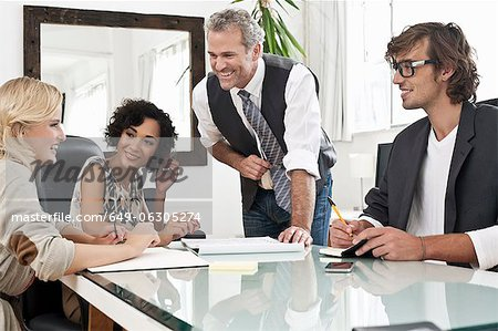 Business people working together at desk Stock Photo - Premium Royalty-Free, Image code: 649-06305274