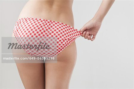 Woman wearing patterned underwear Stock Photo - Premium Royalty-Free, Image code: 649-06305298