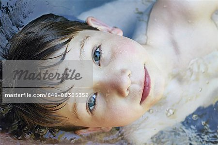 Close up of boys face in river Stock Photo - Premium Royalty-Free, Image code: 649-06305352