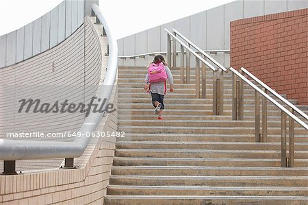 Girl climbing steps outdoors Stock Photo - Premium Royalty-Free, Image code: 649-06305482