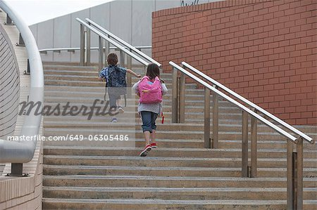 Children climbing stairs outdoors Stock Photo - Premium Royalty-Free, Image code: 649-06305486