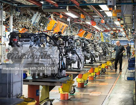 Workers on engine production line in car factory Stock Photo - Premium Royalty-Free, Image code: 649-06305634