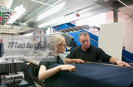 Workers talking in garment factory Stock Photo - Premium Royalty-Free, Image code: 649-06305899