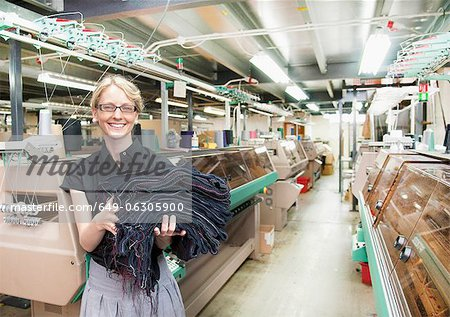 Worker with fabric in garment factory Stock Photo - Premium Royalty-Free, Image code: 649-06305900